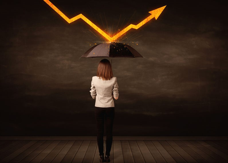 Business woman with umbrella avoiding arrow-1